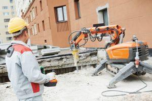 Portland excavation worker using a demolition machine