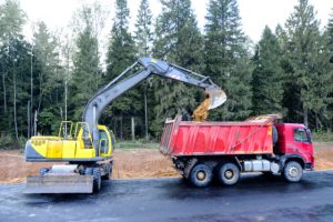 Portland Dump Truck with an excavator loading